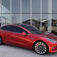 A Tesla Motor Inc. Model 3 vehicle is displayed outside the company's Gigafactory in Sparks, Nevada, on July 26, 2016, the day Tesla officially opened the facility in partnership with leading lithium-ion battery maker Panasonic. The factory is about 30 percent complete, but when it's finished it will be about about the size of 262 NFL football fields.   BLOOMBERG