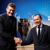 Bayern Munich executive board member Andreas Jung (left) and Real Madrid director of institutional relations Emilio Butragueno pose with the Champions League trophy after Friday's draw at UEFA headquarters in Nyon, Switzerland.   REUTERS