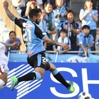 Frontale's Eduardo Neto scores a second-half goal against the Antlers on Saturday at Todoroki Stadium. Kawasaki beat Kashima 4-1. | KYODO