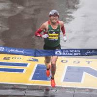 Yuki Kawauchi crosses the finish line to win the Boston Marathon on Monday. Kawauchi won in a time of 2 hours, 15 minutes, 58 seconds, becoming the first Japanese man to win since 1987. | AFP-JIJI