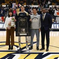 George Washington University senior star Yuta Watanabe, joined by his parents Kumi and Hideyuki and coach Maurice Joseph, was honored before the team's final home game of the 2017-18 season on Feb. 28. | GW ATHLETICS