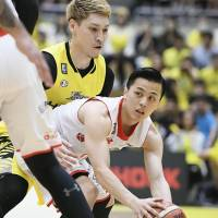 Chiba's Yuki Togashi looks to pass the ball during the Jets' 71-67 win over the Sunrockers on Sunday at Aoyama Gakuin University Memorial Hall. | KYODO