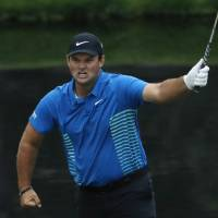 Patrick Reed leads Rory McIlroy by three shots at Masters