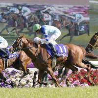 Rainbow Line (far side) comes home to win the spring Tenno-sho on Sunday at Kyoto Racecourse. | KYODO