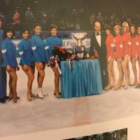 Emi Watanabe (fourth from left), competed in the 1980 World Professional Figure Skating Championships in Landover, Maryland. Organizer Dick Button stands in the middle in a tuxedo. Olympic champions Dorothy Hamill (next to Button), Peggy Fleming (fourth from right) and Robin Cousins (second from left) also competed in the event. EMI WATANABE