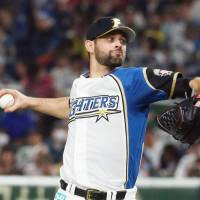 Fighters hurler Nick Martinez pitches against the Marines on Friday night at Tokyo Dome. Hokkaido Nippon Ham edged Chiba Lotte 3-2. | KYODO
