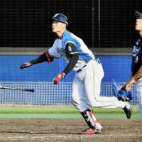 Hokkaido Nippon Ham's Kotaro Kiyomiya hits a home run against Chiba Lotte's Yuji Nishino during a farm team game on Friday. | KYODO