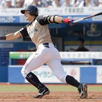 The Fighters' Taishi Ota belts a third-inning homer against the Marines on Saturday at Zozo Marine Stadium. Ota hit two homers in Hokkaido Nippon Ham's 5-2 victory over Chiba Lotte. | KYODO
