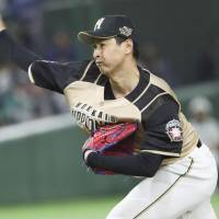 Toru Murata, one of six Fighters relievers on Tuesday night, pitches against the Lions at Tokyo Dome. Murata worked 2 2/3 innings to pick up the win. | KYODO