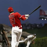 Angels designated hitter Shohei Ohtani hits a home run against Yankees starter Luis Severino on Friday night in Anaheim, California.   KYODO