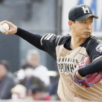 Fighters starter Toru Murata fires a pitch during Thursday afternoon's game against the Eagles in Sendai. Murata pitched eight innings in Hokkaido Nippon Ham's 3-1 win over Tohoku Rakuten. | KYODO