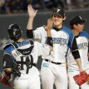 Fighters pitcher Hirotoshi Takanashi (right) celebrates with catcher Yushi Shimizu after Hokkaido Nippon Ham's victory over the Buffaloes on Wednesday in Sapporo.