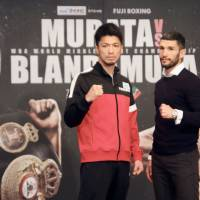 WBA middleweight champion Ryota Murata and challenger Emanuele Blandamura pose at a news conference on Friday ahead of Sunday's title bout in Yokohama. | KAZ NAGATSUKA