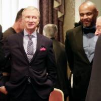 Jimmy Lennon Jr., who will be the ring announced for a Ryota Murata-Emanuele Blandamura WBA middleweight title fight in Yokohama, chats with Top Rank CEO Bob Arum and other boxing officials on Friday in Tokyo. | KAZ NAGATSUKA