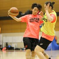 Mio Shinozaki (left) competes during a training camp for the provisional Japan women's national team in Tokyo on Tuesday. | KAZ NAGATSUKA