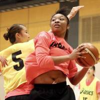 Monica Okoye grabs a rebound during a training camp for the provisional Japan women's national team at Tokyo's National Training Center on Tuesday. | KAZ NAGATSUKA
