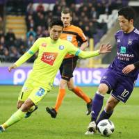 Ghent's Yuya Kubo (left) and Anderlecht's Ryota Morioka face each other in their Belgian Championship playoff game in Brussels on Sunday. | KYODO