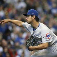 The Cubs' Yu Darvish pitches against the Brewers on Saturday in Milwaukee. | AP