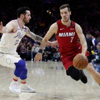 Dwyane Wade turns back clock as Heat surprise 76ers