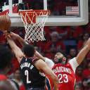 The Pelicans' Anthony Davis (right) defends against Trail Blazers guard Wade Baldwin IV at the rim during the first half on Saturday in New Orleans.
