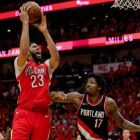 New Orleans star Anthony Davis (left) helped lead the Pelicans past the Portland Trail Blazers in the first round of the NBA playoffs.   DERICK E. HINGLE / USA TODAY / VIA REUTERS