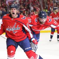 The Capitals' Jakub Vrana (left) celebrates with Brett Connolly after scoring against the Penguins in the first period on Sunday in Washington. | USA TODAY / VIA REUTERS
