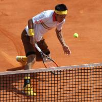 Kei Nishikori hits a return during his first-round win over the Czech Republic's Tomas Berdych at the Monte Carlo Masters on Monday. | AFP-JIJI