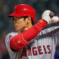 Shohei Ohtani prepares to bat during the ninth inning of the Angels' game against the Rangers on April 10. | AP