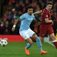 Kyle Walker (left) and his Manchester City teammates face Manchester United on Saturday in a potential title-clinching derby. | AFP-JIJI