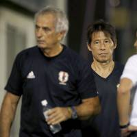 Akira Nishino (right) will lead Japan at the 2018 World Cup after the Japan Football Association confirmed it had fired manager Vahid Halilhodzic (left) on Monday. | KYODO