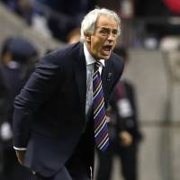 Japan's coach, Vahid Halilhodzic, gives directions to his players during their 2018 World Cup Russia qualifier soccer match at Saitama Stadium in November 2016. | AP