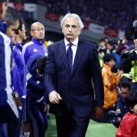 Japan manager Vahid Halilhodzic walks onto the pitch before a friendly against Uzbekistan in Tokyo on March 31, 2015.  Halilhodzic was fired and replaced by Akira Nishino, the Japan Football Association announced Monday, with the 2019 World Cup just over two months away. | AP