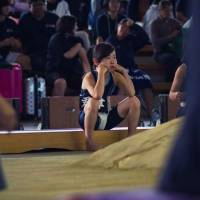 A girl sits beside the ring at the women's national sumo championships in Sakai, Osaka Prefecture, in October 2016. | INSIDE SPORT JAPAN