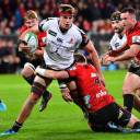 The Sunwolves' James Moore is tackled by the Crusaders' Mitchell Drummond during their match on Saturday in Christcurch, New Zealand.