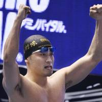 Kengo Ida celebrates his victory in the men's 50-meter butterfly at the Japan Swimming Championships on Wednesday. Ida had a national record time of 23.40 seconds to capture his first national title.   KYODO