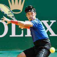 Yuichi Sugita prepares to hit a shot during his Monte Carlo Masters match against Jan-Lennard Struff on Tuesday. | KYODO