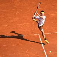 Kei Nishikori plays a shot from Croatia's Marin Cilic in their quarterfinal match at the Monte Carlo Masters on Friday. | AFP-JIJI
