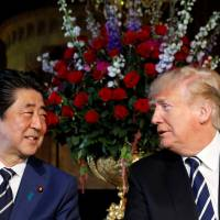 Prime Minister Shinzo Abe meets with U.S. President Donald Trump at his Mar-a-Lago estate in Palm Beach, Florida, on April 17. | REUTERS