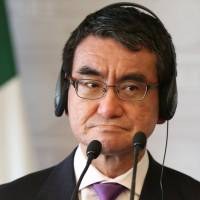 Foreign Minister Taro Kono listens to his Mexican counterpart, Luis Videgaray, while delivering a joint message in Mexico City on May 24. Japan is considering arranging a meeting between Kono and his North Korean opposite, Ri Yong Ho, in Singapore in early August. | REUTERS