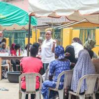 Nkem Okocha (center) leads Mamamoni, a group that helps empower impoverished women by teaching them new skills and microfinancing their businesses. | SOLOMON ADETOKUNBO