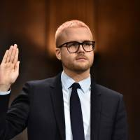 Cambridge Analytica former employee and whistleblower Christopher Wylie is sworn in before he testifies at the Senate Judiciary Committee on Cambridge Analytica and data privacy in the Dirksen Senate Office Building on Capitol Hill in Washington Wednesday. | AFP-JIJI