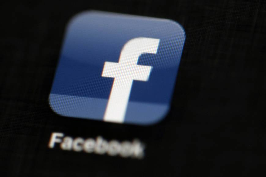 The Facebook logo is displayed on an iPad in Philadelphia in 2012. Facebook says it is banning foreign advertisements related to Ireland's abortion referendum amid concerns that North American groups are trying to influence the campaign. Irish voters will decide May 25 whether to repeal a constitutional ban on abortion, in a referendum that has drawn international attention.   AP