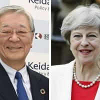 Hitachi Ltd. Chairman Hiroaki Nakanishi held talks with British Prime Minister Theresa May in London on May 3 over the U.K.'s financial support for Hitachi's nuclear power project in Wales. | KYODO