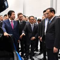 Chinese Premier Li Keqiang visits Toyota's EV parts factory in Hokkaido