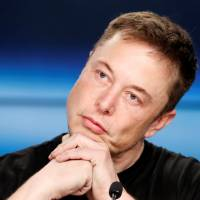Tesla boss Elon Musk bashes media, proposes credibility check and gains Twitter fans
