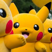 Performers dressed as the Pikachu character from Nintendo Co.'s Pokemon franchise march at the Pikachu Carnival Parade organized by Pokemon Co. in Yokohama on Aug. 14, 2017. Nintendo is bringing together the appeal of Pokemon, smartphones and the Switch console to create an interlinked gaming experience. | BLOOMBERG