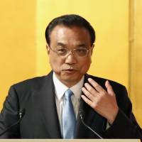 Chinese Premier Li Keqiang speaks at a reception in Tokyo on Thursday. | KYODO