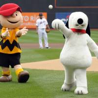 Snoopy throws out the ceremonial first pitch while Charlie Brown looks on prior to the New York Mets playing the Houston Astros in a baseball game at Citi Field in New York in October 2009. | AP