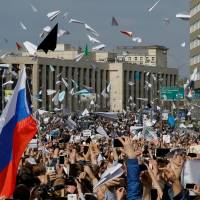 Paper plane protesters urge Russia to unblock Telegram app, which Iran also banned