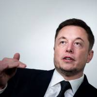 Elon Musk, CEO of SpaceX and Tesla, speaks during the International Space Station Research and Development Conference at the Omni Shoreham Hotel in Washington last July. Musk told employees Monday the carmaker is being reorganized to speed up production of Model 3 vehicles — a key to profitability at the fast-growing firm.   AFP-JIJI